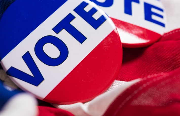 http://www.shutterstock.com/pic-312100718/stock-photo-a-vote-pin-or-button-on-a-flag-of-the-united-states.html