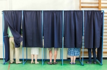 http://www.shutterstock.com/pic-435657658/stock-photo-color-image-of-some-people-voting-in-some-polling-booths-at-a-voting-station.html