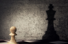 http://www.shutterstock.com/pic-383190772/stock-photo-pawn-chess-piece-casting-a-shadow-of-a-king-on-a-concrete-wall-business-aspirations-and-leadership-concept-magical-transformation.html