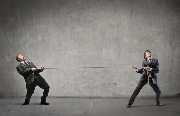 http://www.shutterstock.com/pic-106134929/stock-photo-two-businessmen-playing-tug-of-war.html