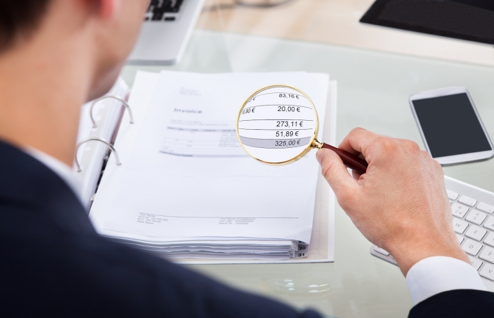 http://www.shutterstock.com/pic-184351511/stock-photo-cropped-image-of-auditor-examining-invoice-with-magnifying-glass-at-desk.html?src=y_QltST4rdt94Xr43K_wQQ-1-12