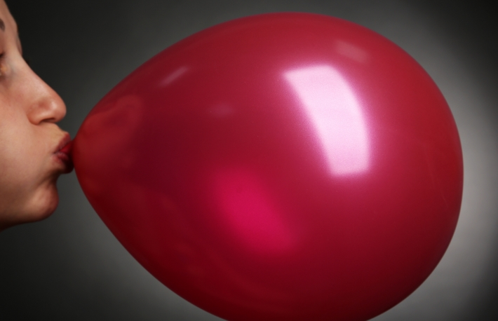 http://www.shutterstock.com/pic-312429194/stock-photo-young-woman-inflating-balloon-on-gray-background.html