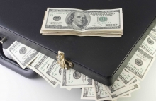 http://www.shutterstock.com/pic-59764018/stock-photo-briefcase-full-of-dollars-with-a-stack-of-bills-over.html