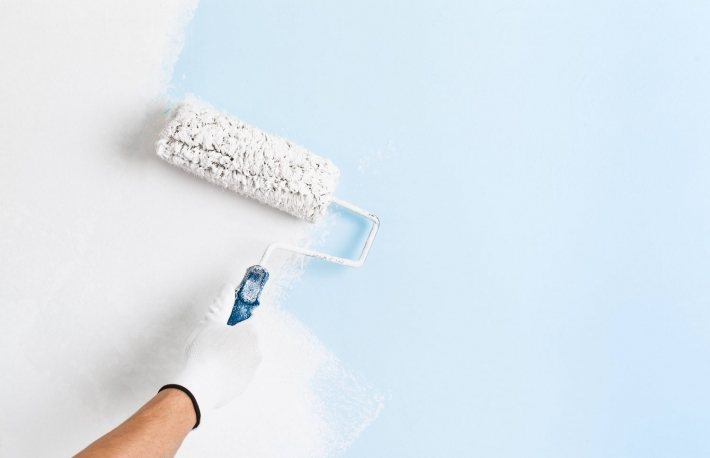 http://www.shutterstock.com/pic-374666983/stock-photo-close-up-of-painter-hand-in-white-glove-painting-a-wall-with-paint-roller-copy-space.html