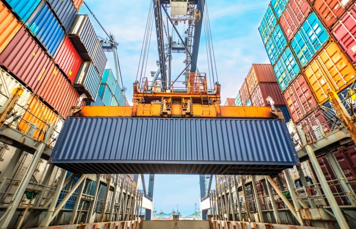 http://www.shutterstock.com/pic-214476049/stock-photo-industrial-crane-loading-containers-in-a-cargo-freight-ship.html