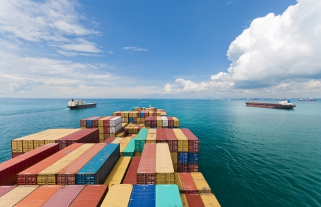 http://www.shutterstock.com/pic-104909027/stock-photo-cargo-ships-entering-one-of-the-busiest-ports-in-the-world-singapore.html?src=Fm6JSWb3gocBStLmHauw1w-1-51