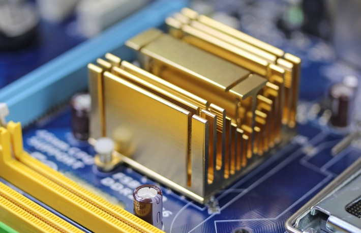 http://www.shutterstock.com/pic-272301215/stock-photo-golden-radiator-on-blue-microchip-close-up.html?src=PNnn3RAPJ0tXTe_D9rZ8pw-1-48