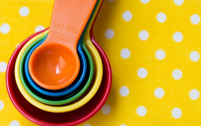 http://www.shutterstock.com/pic-403005196/stock-photo-colorful-measuring-spoon-on-yellow-background.html?src=kvzBhqt1xfCMlmkAKegSzA-1-10