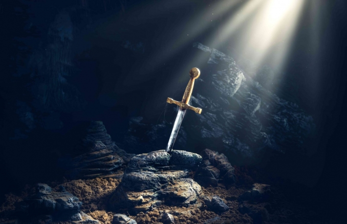 http://www.shutterstock.com/pic-421592200/stock-photo-high-contrast-image-of-excalibur-sword-in-the-stone-with-light-rays-and-dust-specs-in-a-dark-cave.html