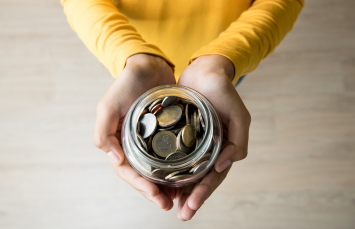 http://www.shutterstock.com/pic-439690462/stock-photo-young-woman-hands-holding-glass-jar-with-coins-inside-top-view.html?src=WH-9wzBC3GQ0OX2nI1DSrg-1-1