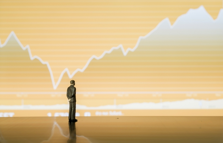 http://www.shutterstock.com/pic-228189730/stock-photo-businessman-miniature-look-at-the-stock-chart-tablet.html?src=riqavEj2whRWb5hCH6AImw-1-24