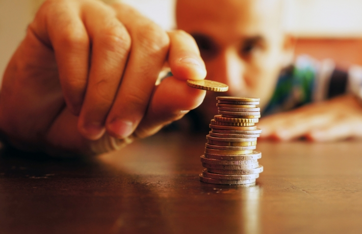 http://www.shutterstock.com/pic-112962751/stock-photo-a-man-counts-his-coins-on-a-table.html?src=TgfEAJDm70ESyyLmXLeVWQ-1-7