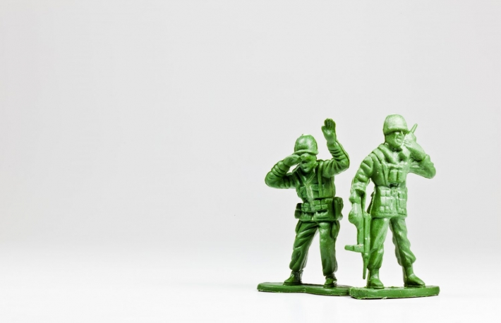 http://www.shutterstock.com/pic-99004676/stock-photo-the-isolated-image-of-two-green-plastic-toy-soldiers.html?src=UPCYh2fc63-1B0giPlT4JQ-1-22