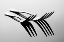 http://www.shutterstock.com/pic-71509117/stock-photo-abstract-image-for-kitchen-two-forks-with-reflection.html