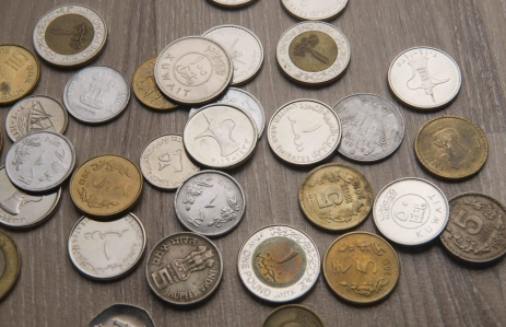 http://www.shutterstock.com/pic-370461023/stock-photo-assorted-currency-coins-from-uae-india-kuwait-and-egypt.html