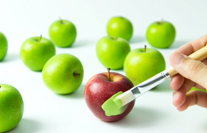 http://www.shutterstock.com/pic-443570983/stock-photo-concept-of-assimilation-by-painting-red-apple-into-green-color.html?src=GdbyOLGMg67Z7fDTPqD0mQ-1-0