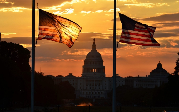 http://www.shutterstock.com/pic-113389501/stock-photo-united-states-capitol-building-silhouette-and-us-flags-at-sunrise-washington-dc.html