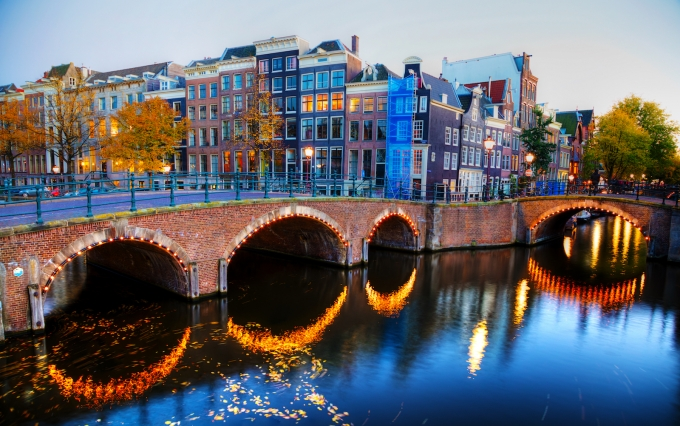 http://www.shutterstock.com/pic-518352742/stock-photo-amsterdam-city-view-with-canals-and-bridges-in-the-evening.html
