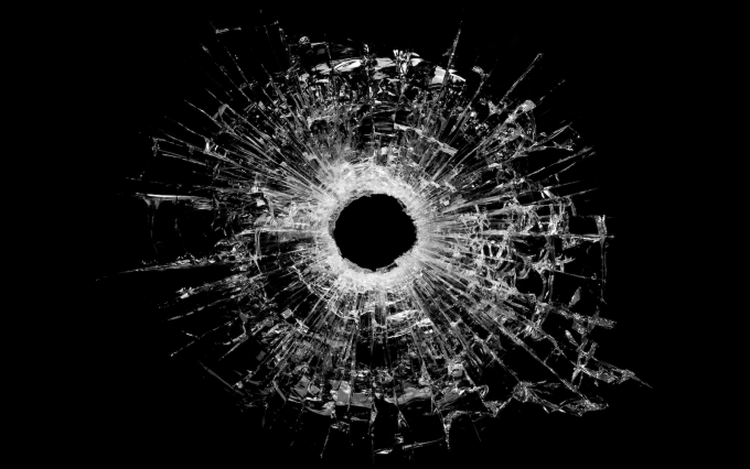 http://www.shutterstock.com/pic-73981462/stock-photo-bullet-hole-in-glass-real-bullet-hole-closeup-and-isolated-on-black.html