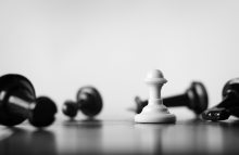 http://www.shutterstock.com/pic-146789738/stock-photo-single-white-pawn-on-a-chess-board-surrounded-by-a-number-of-fallen-black-chess-pieces-with-selective-focus.html