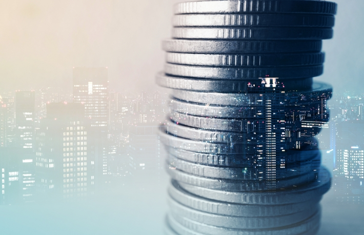 https://www.shutterstock.com/pic-522559927/stock-photo-double-exposure-of-city-and-row-of-coins-for-finance-and-banking-concept.html
