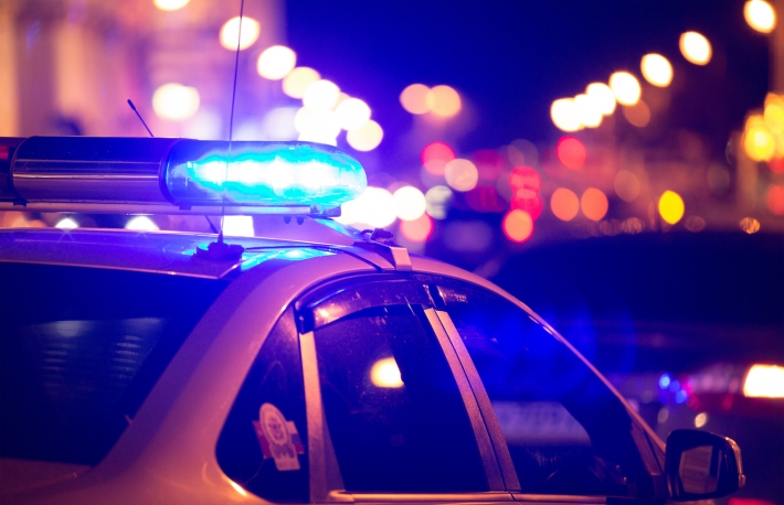 http://www.shutterstock.com/pic-448997113/stock-photo-blue-light-flasher-atop-of-a-police-car-city-lights-on-the-background.html?src=N6Uzg86pObR4yFUYaOL3Gg-1-0