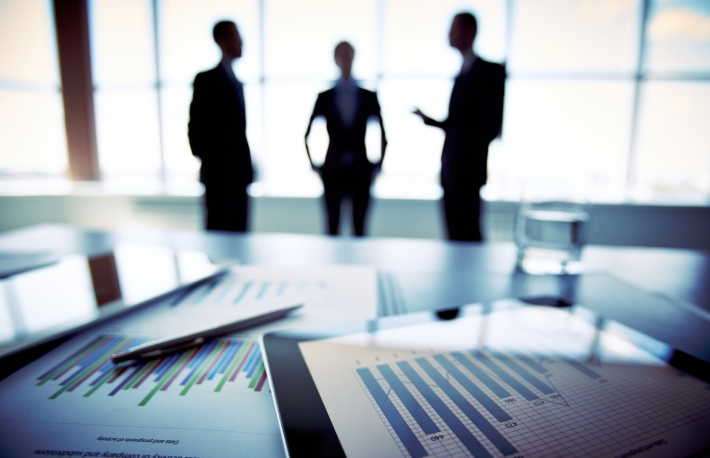 http://www.shutterstock.com/pic-147963821/stock-photo-close-shot-of-a-tablet-computer-displaying-financial-data-three-businessmen-standing-in-the-background.html?src=MYwl6Xnyzl51tBVUJ9NM9A-1-28