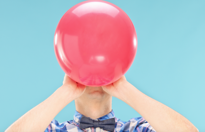 http://www.shutterstock.com/pic-193852706/stock-photo-man-blowing-up-a-balloon-on-blue-background.html