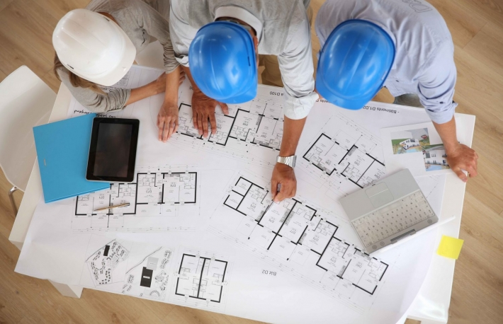 http://www.shutterstock.com/pic-152876009/stock-photo-upper-view-of-architects-working-on-blueprint.html