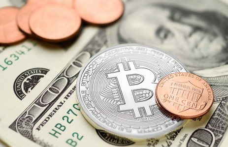 http://www.shutterstock.com/pic-502899937/stock-photo-bitcoin-and-one-cent-coins-on-us-dollar-bills-electronic-money-exchange-concept.html