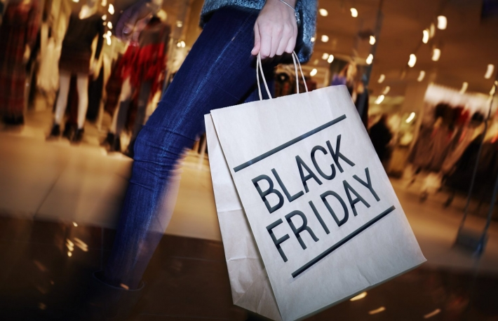 https://www.shutterstock.com/pic-337424894/stock-photo-modern-shopper-with-black-friday-paperbag-going-in-the-mall.html