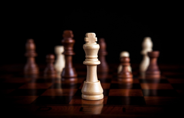http://www.shutterstock.com/pic-355157579/stock-photo-chess-pieces-with-the-king-in-the-center.html