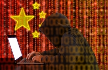 http://www.shutterstock.com/pic-493959418/stock-photo-hacker-in-a-dark-hoody-sitting-in-front-of-a-notebook-with-digital-chinese-flag-background-and-binary-streams-cybersecurity-concept.html