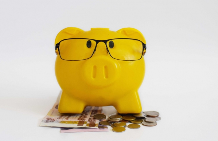 https://www.shutterstock.com/pic-524168032/stock-photo-smart-yellow-piggy-bank-wear-black-glasses-on-thai-banknotes-and-coins-on-white-background-isolated.html