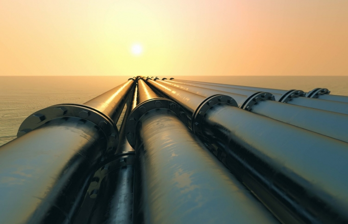 http://www.shutterstock.com/pic-141093514/stock-photo-tubes-running-in-the-direction-of-the-setting-sun-pipeline-transportation-is-most-common-way-of-transporting-goods-such-as-oil-natural-gas-or-water-on-long-distances.html