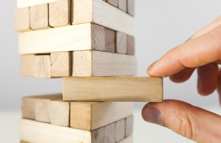http://www.shutterstock.com/pic-367446221/stock-photo-the-tower-from-wooden-blocks-and-mans-hand-take-one-block.html?src=IS6xqr1tMghoUukbkD3fIA-1-0