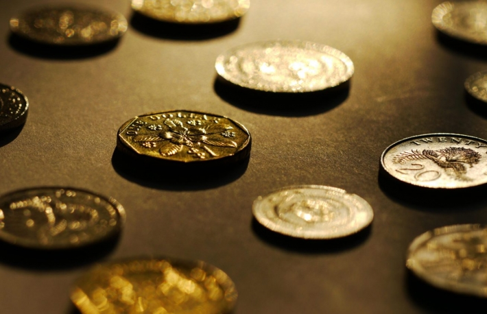 http://www.shutterstock.com/pic-127465562/stock-photo-big-close-up-of-singapore-dollar-coins.html