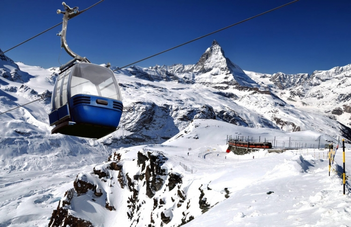 http://www.shutterstock.com/pic-243881395/stock-photo-cable-car-with-ski-slope-in-mountains-near-zermatt-switzerland-swiss-alps-with-matterhorn-peak-cervino-train-and-ski-lift.html
