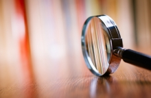 https://www.shutterstock.com/pic-231292906/stock-photo-close-up-single-magnifying-glass-with-black-handle-leaning-on-the-wooden-table-at-the-office.html?src=RdNUgDFS38D8z0JmH6lFjA-1-22