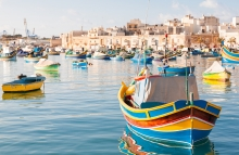 https://www.shutterstock.com/pic-274378319/stock-photo-mediterranean-traditional-colorful-boats-luzzu-fisherman-village-in-the-south-east-of-malta-early-winter-morning-in-marsaxlokk-malta.html?src=6apN-6pHtiFBM4RwSLg2ew-1-1