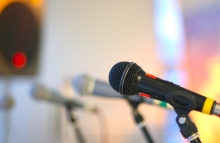 https://www.shutterstock.com/pic-15224596/stock-photo-close-up-microphone-on-the-stage-against-colorful-background.html?src=NzTE70ob8FWxRjKZecDRxg-1-5