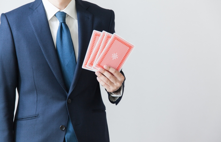 https://www.shutterstock.com/pic-518207836/stock-photo-a-businessman-holding-cards.html