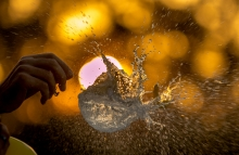 https://www.shutterstock.com/pic-369968054/stock-photo-water-balloon-burst-against-a-sunset-background-creating-an-explosion-of-water-droplets.html