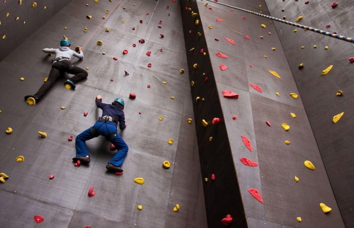 https://www.shutterstock.com/pic-60364084/stock-photo-two-young-people-climbing-on-wall.html