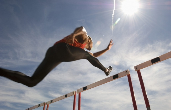 https://www.shutterstock.com/pic-144640304/stock-photo-low-angle-view-of-a-male-athlete-jumping-hurdle-against-the-sky.html