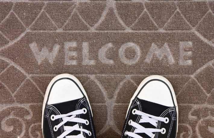 https://www.shutterstock.com/pic-78253276/stock-photo-welcome-carpet-with-foot-ware-on-it.html