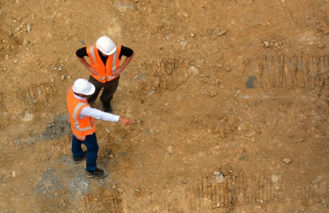 https://www.shutterstock.com/pic-393147385/stock-photo-aerial-view-of-two-unrecognized-civil-engineers-inspecting-construction-site-building-development-concept-with-copy-space.html