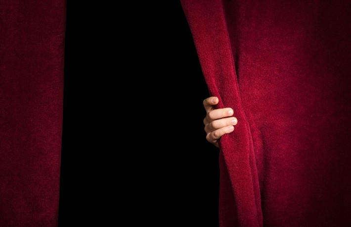https://www.shutterstock.com/image-photo/hand-appearing-beneath-curtain-red-176900831