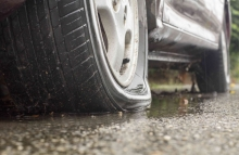 https://www.shutterstock.com/image-photo/car-flat-tire-rainy-day-294815450?src=FN2m0xGGelVtbr8QCToNug-1-0