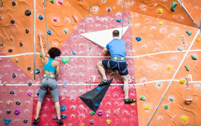 https://www.shutterstock.com/image-photo/fit-couple-rock-climbing-indoors-gym-330268469